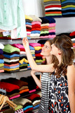 female friends in a retail store buying clothes poster