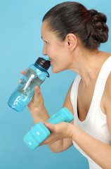 Senior fitness concept with a water bottle and dumbbells