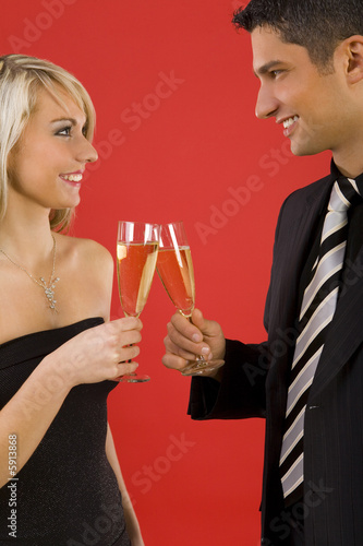 Young elegant couple rising toast.