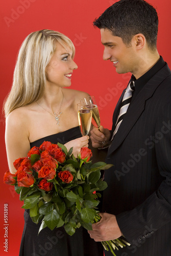 Young couple raising toast.