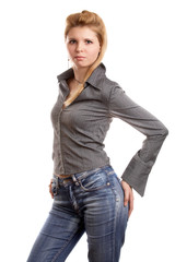Blonde long-haired girl in shirt and jeans on white background.