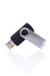 Flash pendrive memory reflected on white background. Shallow DOF