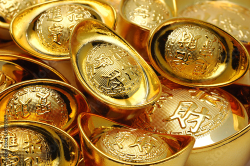 Close up of chinese gold ingot ornaments