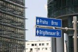 Vienna financial district downtown. Direction signs to Prague. poster