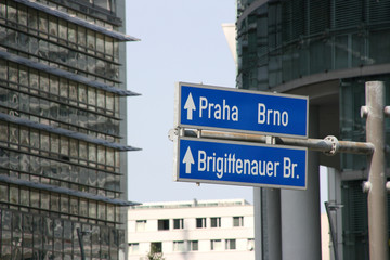Vienna financial district downtown. Direction signs to Prague.