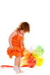 happy girl playing with colorful balloons