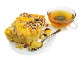 Slice of pie with raisins on white background