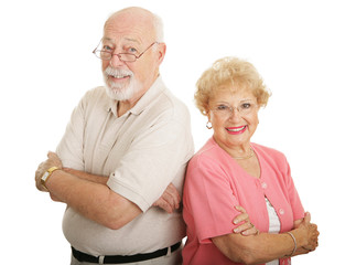 Good looking senior couple with glasses.  Isolated on white.