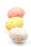 Speckled multicolored chocolate EASTER eggs in row poster