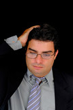Concerned businessman with a hand in his head. poster