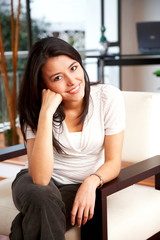 Casual woman portrait relaxing and smiling at home