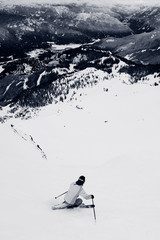 A skier on a steep trail on Whistler Mountain.