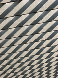 Shadows cast on wooden slats from sunlight poster
