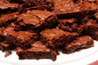 A plate piled full of brownies,