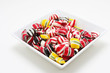 a bowl of hard candy shot on white, very colorful