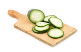 sliced cucumber on wooden plank isolated poster