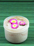 Spa and beauty products - body scrub and flowers. poster