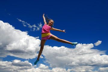 Acrobatic girl in midair