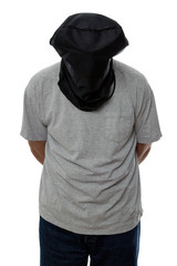Man with a black hood over his head and his hands tied