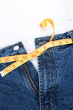 a blue jean and ruler, concept of Overweight poster