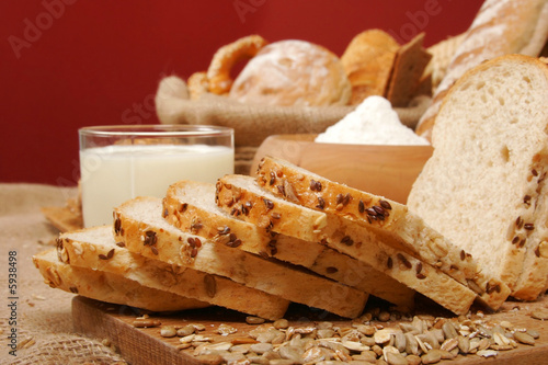 Assortment of baked breads with yogurt and a bowl of flour