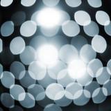 Defocused abstract sparkling lights background poster