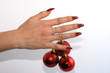 Manicure with red balls on a white background
