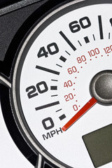 An automobile odometer close up