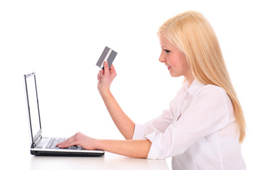 Woman using a laptop and credit card