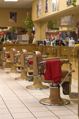Barber Shop image showing chairs in a row
