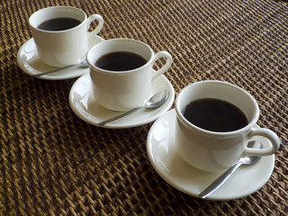 Three cups of coffee in a row