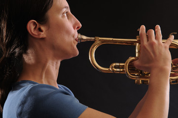 woman playing trumpet