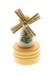 Miniature wooden windmill souvenir on white background