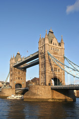 Tower Bridge in London with boat passing underneath