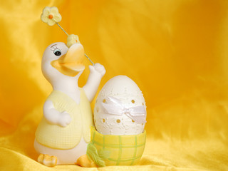 Easter egg on golden sateen background