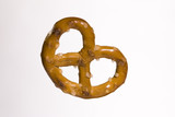 a baked twisted pretzel on a white background poster