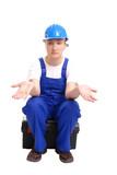 Helpless female builder in blue helmet and jumpsuit poster