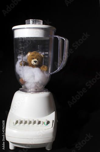 poster of A teddy bear in a blender. Humorous creative cooking.