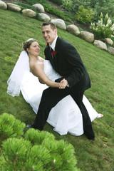 Groom dipping bride dancing outside