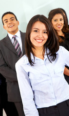 Business woman in front of a team in an office