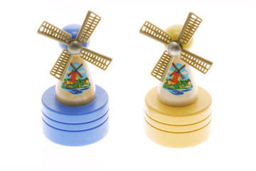 Miniature wooden windmills on white background
