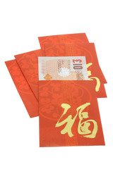 Chinese New Year red packets and British currency notes on white