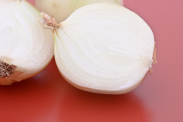 Onions on a red cutting mat