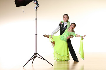 Young dancers posing for photoshoot in ballroom dance studio