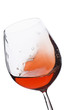 Isolated and moving red wine glass over a white background