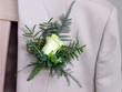 Groom's wedding suit with boutonniere of rose and leaves