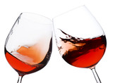 Fototapety pair of moving wine glasses over a white background, cheers!