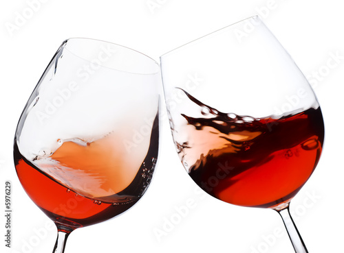 Staande foto Wijn pair of moving wine glasses over a white background, cheers!