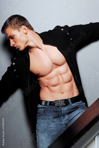 Sexy  bodybuilder posing in studio. Big muscles.
