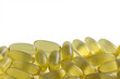 Fish oil capsules against a white background, copy space